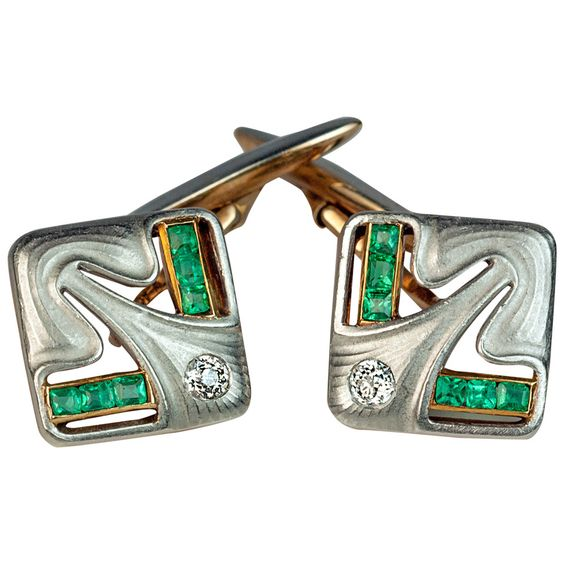 Art Nouveau Jugendstil Antique Diamond Emerald Platinum Gold Cufflinks. European, made between 1899 and 1908, with Russian import marks  The platinum topped 14K gold openwork cufflinks are set with two old European cut diamonds and twelve calibre cut emeralds.  Very fine quality craftsmanship