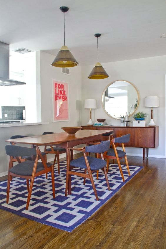 mid-century dining table, graphic rug, fantastic credenza, iconic white and walnut lamps and perfect chairs = mid century love