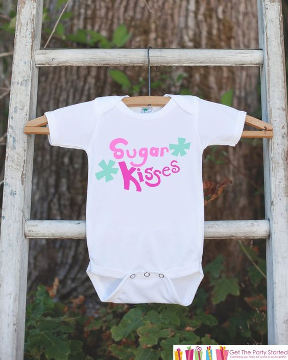 This adorable holiday onepiece is perfect for your children this Valentine's Day! It is just waiting to be worn by the little one in your life! Our graphics are professionally printed directly onto th