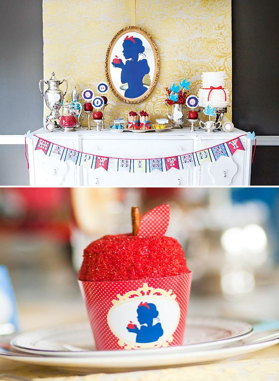 Snow White Inspired Classic Fairy Tale birthday party incorporated a bit of vintage with a bit of royalty, while still remaining whimsical and kid friendly! Poisonous candy apples, fairy tale blue bird cookies, candy gem embellished cupcakes, printable elements and a pretty white ruffle cake are all elements that brought this storybook theme to life.