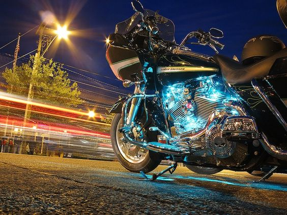 "Motorcycle (above) - ""I am mesmerized by all the neon lights people now put on their scooters. While at Lake George, on a bike trip, the main drag was a wall of bikes and people. I went looking for neon, and saw this bike. I pushed my way through the crowd, got on my hands and knees, put the camera on the ground, and shot this bike while being called different, inappropriate names. ""-Steve Lesnick http://www.workbook.com/blog/14331"