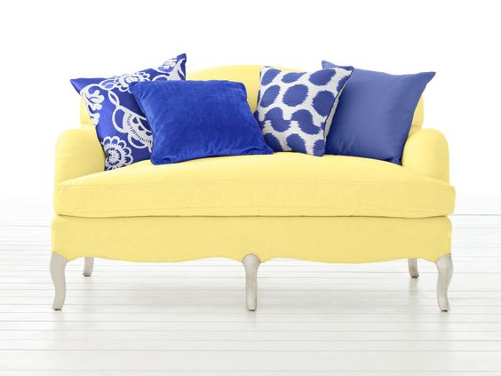With such a bold yellow sofa, it's a good idea to limit your pillow picks to various shades of blue. The contrast is totally punchy, but the effect is so classic.