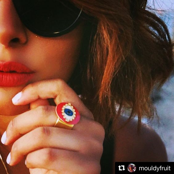 Zara from Mouldyfruit blog Spotted wearing our #danalevy neon evil eye ring