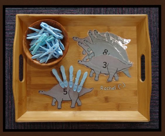 """Pegs on numbered dinosaurs (free printable) from Rachel ("""",)"""