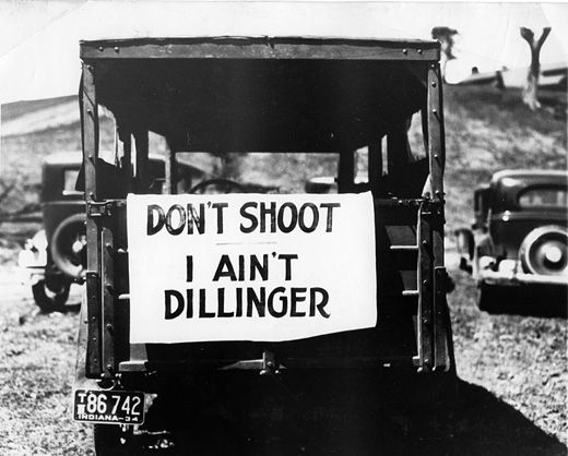 Drivers across the border were compelled to post signs on cars to ward off police looking for the Chicago gangster, 1933, Chicago.