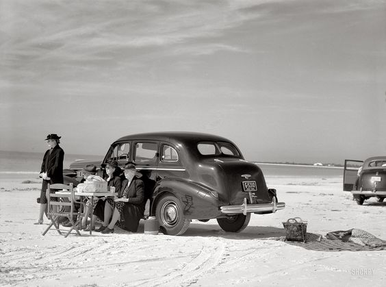 "Marion Post Wolcott - ""Guests of Sarasota trailer park picnicking at the beach."" January 1941. Sarasota, Florida."