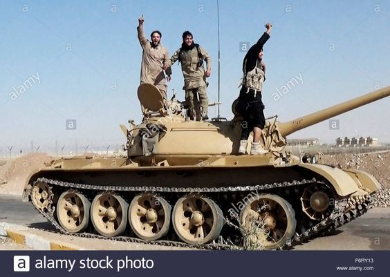 Islamic State of Iraq and the Levant propaganda photo showing masked militants on a tank in Syria.