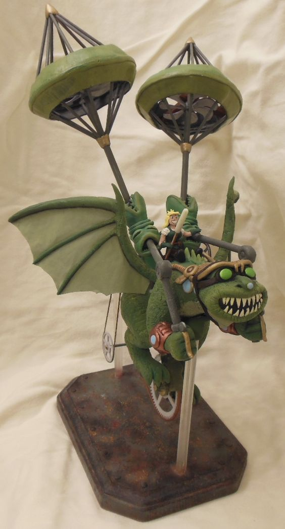 Franz the Heterodyne dragon riding his sky-copter. A l'il Agatha rides on top. Apoxie Sculpt, wood, plastic, paper, wire, clock gears, string, and paint.