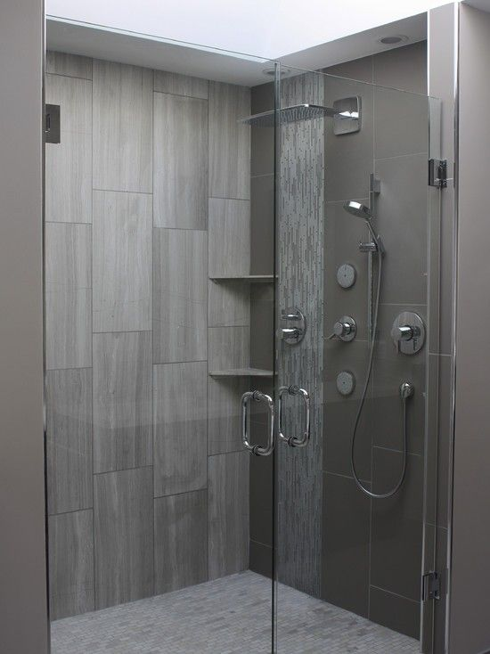 love the vertical large subwaytype tiles good subtle shelves may be too small butthe shower is gorgeous bathroom pinterest shelves bath and