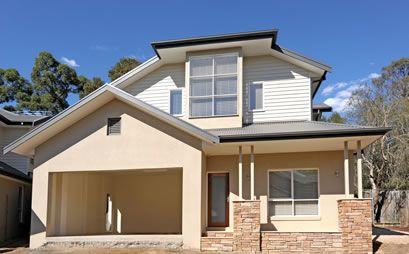 Brick render weatherboard pitch the garage roof new for Weatherboard garage designs