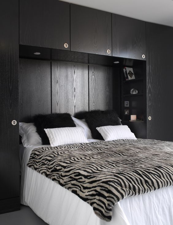 Master bedroom with bespoke black ash over bed storage for Built in bedroom storage ideas