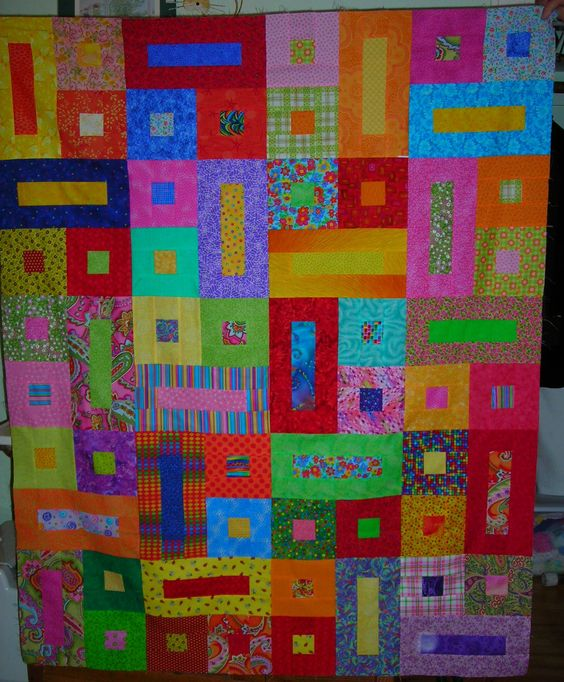 This is a quilt I made for a sick child.  I liked the pattern and it's a great scrappy quilt.  I think they may have been swap blocks.