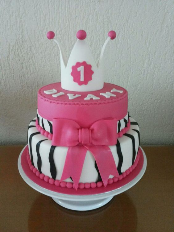 Girl's cake with a large bow, a gumpaste crown and Zebra stripes