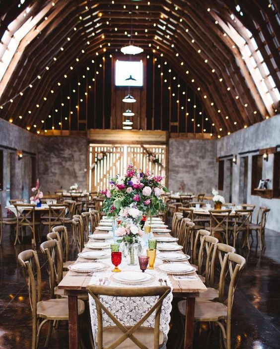 These Gorgeous Mountain Wedding Venues Will Blow You Away | Martha Stewart Weddings - Overlook Barn in Banner Elk, North Carolina. After renovating an old barn for their nuptials, the owners decided to rent it to others dreaming of a Blue Ridge Mountain event. Twinkling lights hang from 30-foot rafters in the gray-walled space, which is outfitted with reclaimed-wood tables and cross-back chairs.