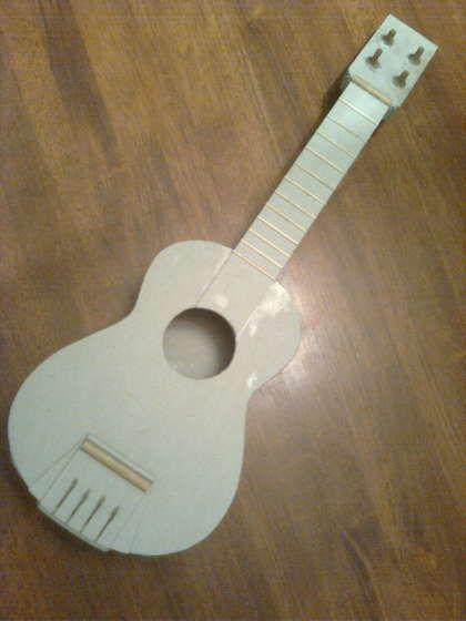 Make a cardboard ukulele.  instructables.com