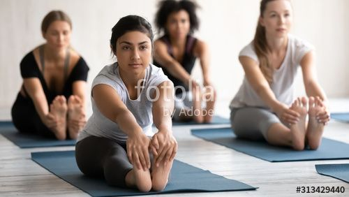 Indian Woman Practicing Yoga At Group Lesson Seated Forward Bend Spon Practicing Yoga Indian Woma In 2020 Indian Women Social Media Marketing Facebook Yoga