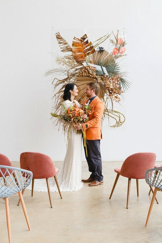 Wedding couple at modern wedding ceremony with dried flowers