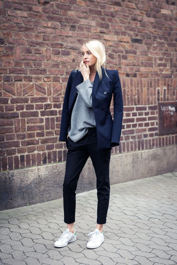 Street Style 2015: Ellen Claesson is wearing a navy blue blazer and black trousers from Zara with a COS grey sweater and Stan Smith sneakers: