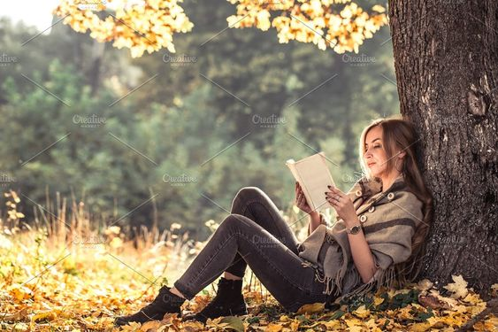 beautiful girl reading a book in autumn forest by puhimec on @creativemarket