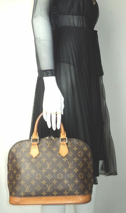 956956a0d912a Offered in Catawiki s Fashion auction (Bags)  Louis Vuitton - Mongram Alma Tote  Bag. Various Browns in Monogram PVC