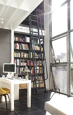 Industrial ladder over a bookcase with lots of natural light