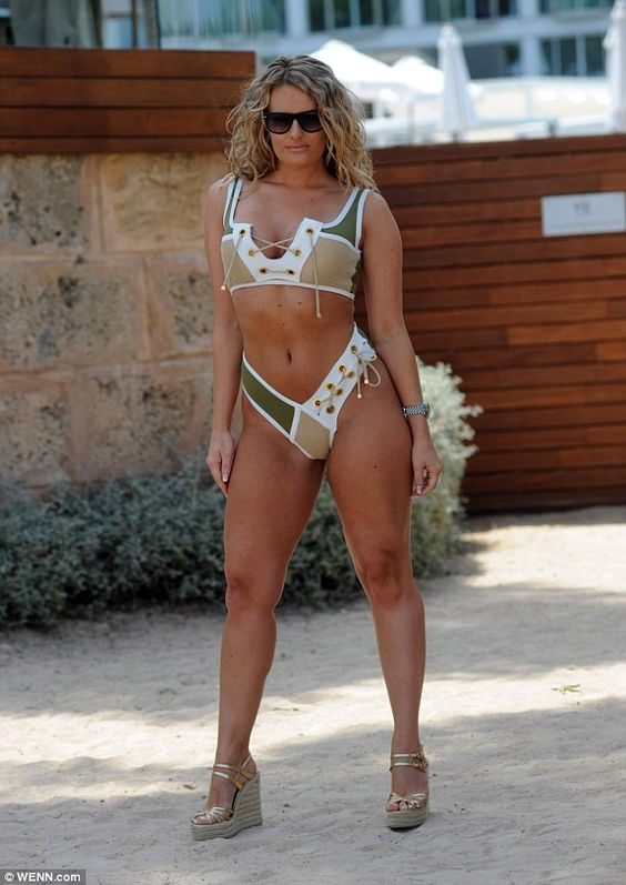 Check her out!The 28-year-old boutique owner was determined to turn heads as she slipped into a sports-inspired bikini with panels of khaki, mesh and lace-up details