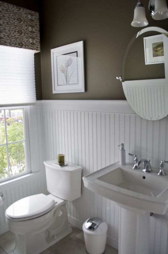 High contrast powder room dark walls white beadboard - Bathroom remodel ideas with wainscoting ...