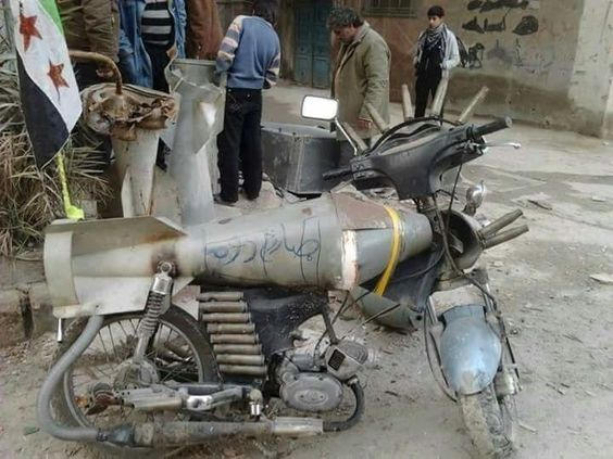 A bomb shell that was recycled into a motorbike in Syria.