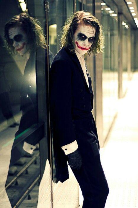 Joker-- that's a good cosplay. Looks like he's going to a shot gun wedding-- hehe