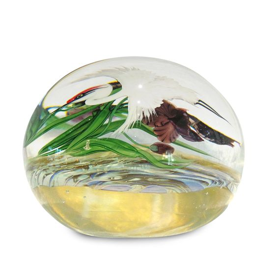 """Lundberg Studios has a beautiful line of paperweights with gorgeous detail.  Featured below is the White Crane with Purple Iris Tea Garden Paperweight.   This stunning and detailed paperweight is 3.5"""" in diameter and 3"""" tall. #paperweight #lundberg #artglass #stunning #beautiful #orlando #winterpark"""