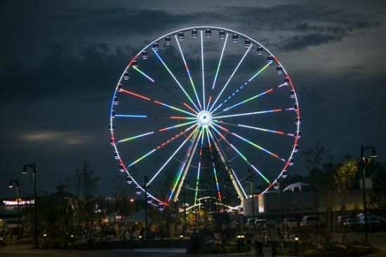 The Great Smoky Mountain Wheel at night (towering 200 feet tall) is the new must-see attraction at The Island in Pigeon Forge, TN.