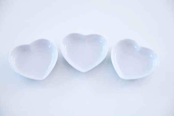 Little white porcelain heart shaped dishes - set of 3. Perfect for table decoration or as a ring / jewelry dish / teaspoon rest or tea bag disg. (shabby chic / cottage chic) via ETSY. $15.99
