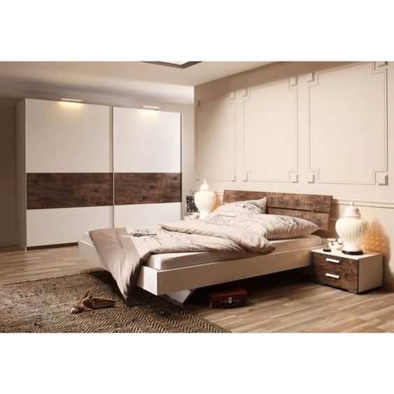 Lit 2 personnes 180 x 200 cm Rauch. Offrez à votre chambre à coucher une touche originale avec ce lit qui combine des lignes sobre et intemporelles et une touche de vintage à l'accent industriel. Avec ses grandes dimensions, vous disposez d'un lit king size très accueillant !