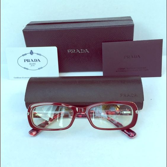 Dark red Prada glasses Authentic glasses with current prescription on left -3.75 and right -4.00. Of course you can take these to your optometrist and they can make lenses for your vision. The frames alone were $400 plus I only used them a handful of times and started using contacts instead. Comes with everything picture on the cover shot. I love this shade of dark red so different from everything I've seen. No trading bundle and save!  Prada Accessories Glasses