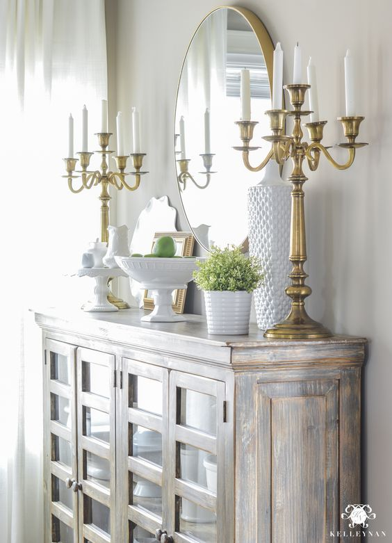 Updated Breakfast Nook- A Lighter, Brighter Look - Kelley Nan- Updated Breakfast Nook- A Lighter, Brighter Look - Kelley Nan Round Brass Mirror over Buffet with Candelabras. Shelf Styling Ideas. Perfect Greige Sherwin Williams Paint: