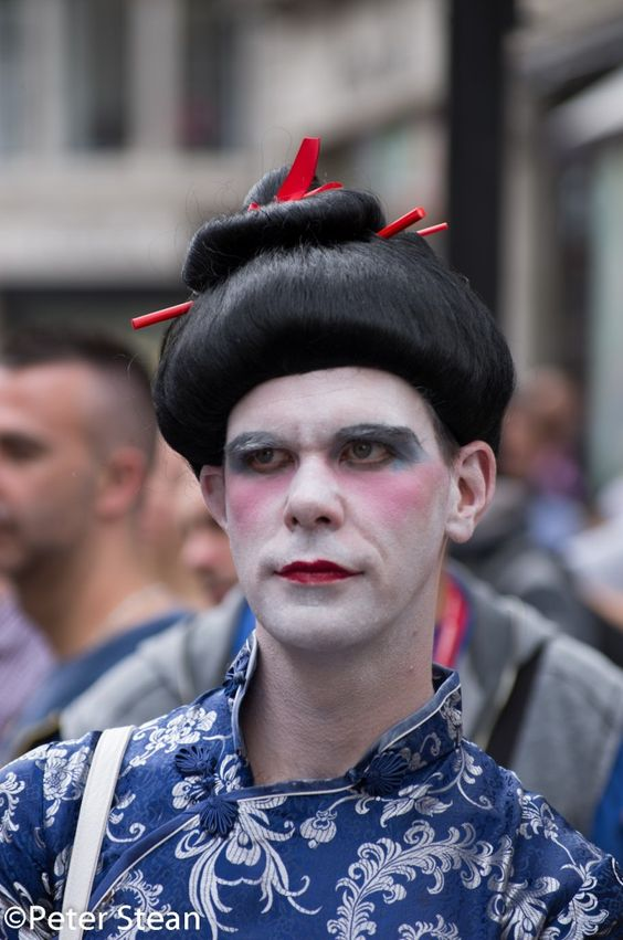 A rather glum 'geisha girl' at the World Pride March in London on 7 July 2012