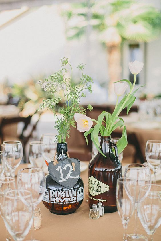 beer bottle centerpieces - photo by Brett and Tori Photographers http://ruffledblog.com/yucaipa-wedding-with-craft-beer #centerpiece #weddingideas #weddingcenterpieces