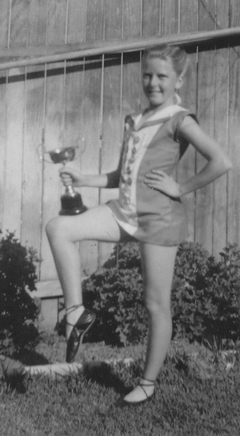 Cup winner in tunic and ballet shoes