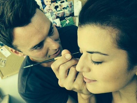 Peter mooney trying to do Priscilla Faia make up while setting on rookie blue