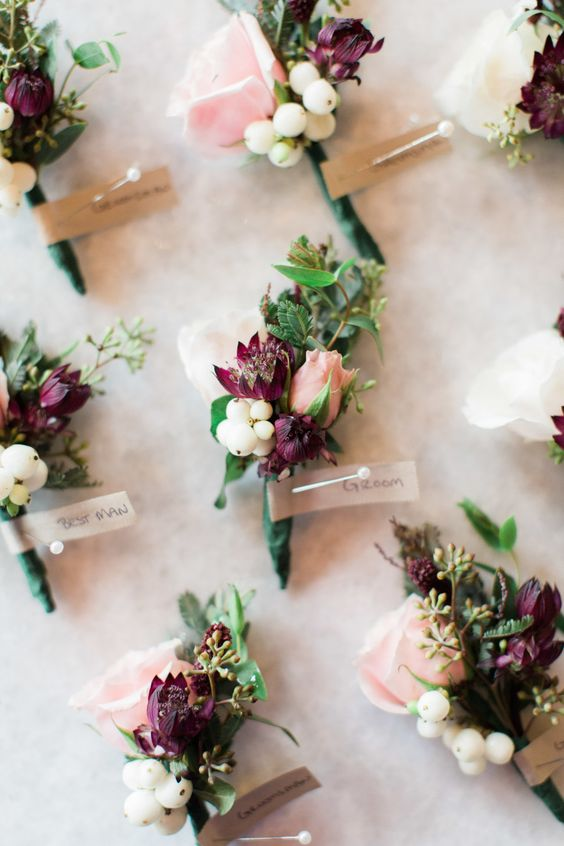 Blush, berry and ivory boutonnieres: Photography: Rowa Lee of Judy Pak Photography - judypak.com   Read More on SMP: http://www.stylemepretty.com/2017/01/31/rainy-day-romance-in-new-york-city/