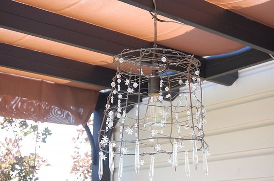 This is too cute! a chandelier made from an old tomato cage!