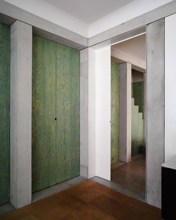 kgdvs / villa schor, green stained plywood, concrete, Loosian look but created with very different materials.