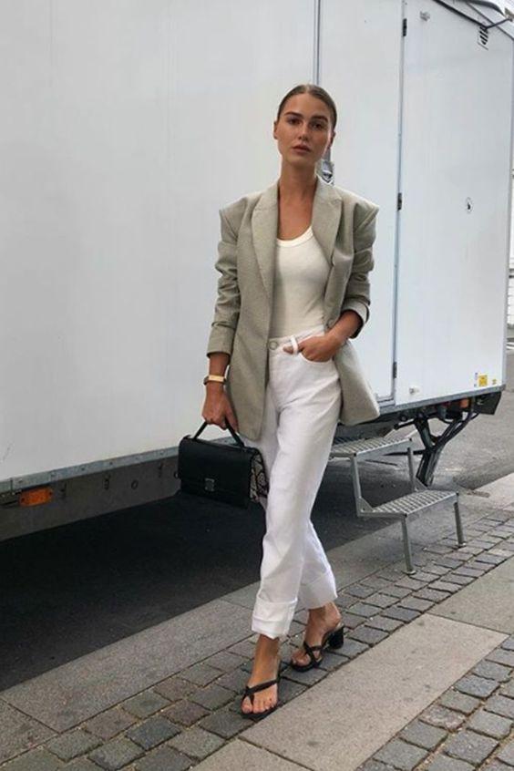 Copenhagen fashion week street style: Sophia Roe wears white jeans and beige jacket