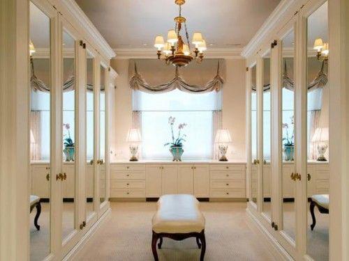 white closet with mirrors