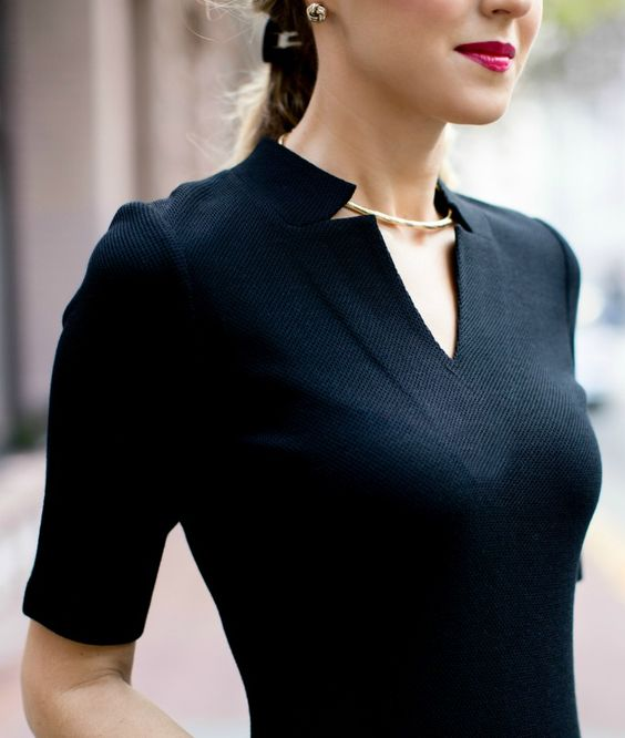 The notched neckline on this black sheath dress is to die for. #stjohnknits #spring2015