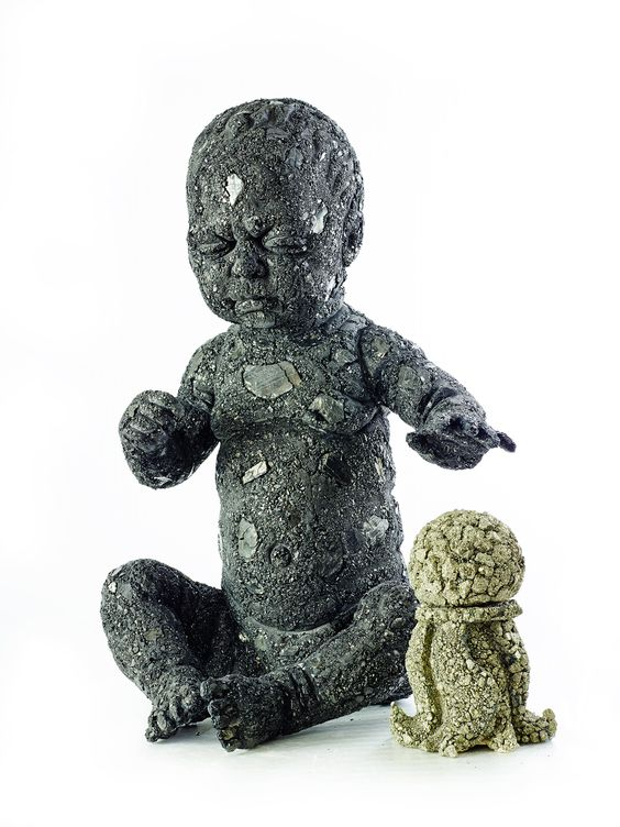 "Vladimir Anselm,""Baby"", 2013. Sculpture in coal. Courtesy of the artist & Oneiro gallery"