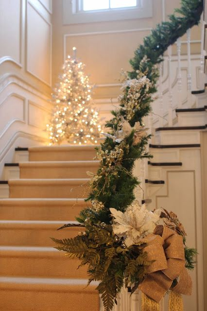 A corner, slim tree on the staircase would be a great look for the foyer!