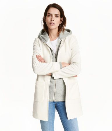 Natural white. Short coat in texture-woven fabric. Open at front