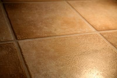 How to Clean Rough/Texture Tile Floors: Mix 2 tbsp ph neutral dishwashing detergent with 1 gallon of water. Dip bristle brush in cleaning mixture and scrub.