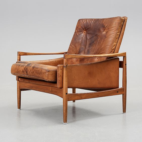 Ib Kofod Larsen; Teak and leather Lounge Chair for OPE, c1960.